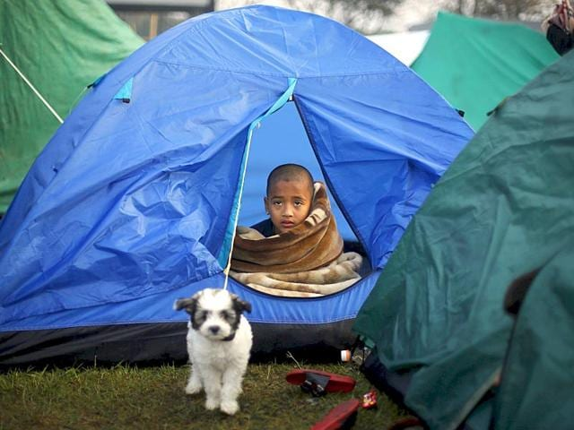 A-boy-sits-inside-a-tent-on-an-open-ground-after-Saturday-s-earthquake-in-Kathmandu-Nepal-early-April-29-2015-Reuters-Photo