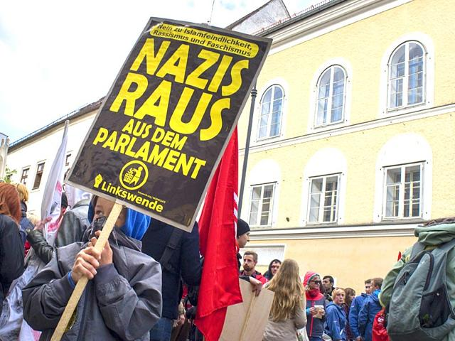Protesters-gather-outside-the-house-where-Adolf-Hitler-was-born-during-the-anti-Nazi-protest-in-Braunau-Am-Inn-Austria-The-weatherworn-three-storey-structure-in-the-town-has-stood-empty-since-2011-and-cannot-be-knocked-down-because-it-is-a-listed-building-although-not-because-of-Hitler-AFP-Photo