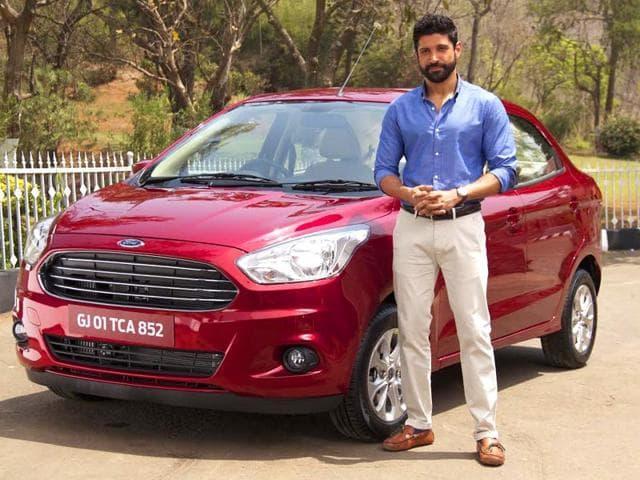 Farhan-Akhtar-strikes-a-pose-with-Ford-s-upcoming-car-Figo-Aspire