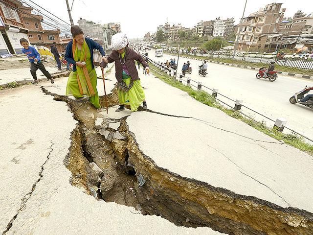 People-walk-through-a-damaged-site-two-days-after-the-earthquake-in-Kathmandu-Raj-K-Raj-HT-Photo