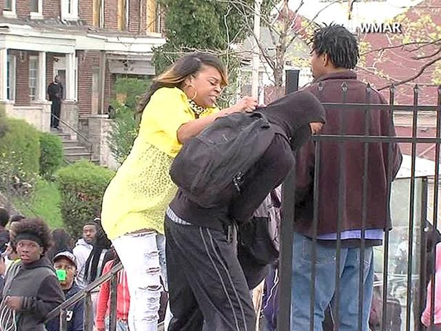 A-woman-striking-a-hooded-youth-identified-by-local-media-as-Toya-Graham-and-her-16-year-old-son-Michael-is-seen-in-a-still-image-from-a-video-in-Baltimore-Reuters