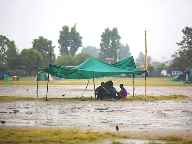 Earthquake-victims-sit-under-a-makeshift-shelter-as-it-rains-in-Kathmandu-Nepal-April-30-2015-Reuters-Photo