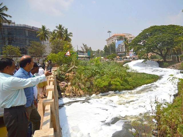 Residents-point-to-foam-which-is-spilling-onto-the-streets-from-the-Varthur-lake-in-Bengaluru-Karnataka-HT-Photo-Kashif-Masood