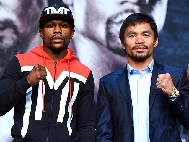 WBC-WBA-welterweight-champion-Floyd-Mayweather-Jr-and-WBO-welterweight-champion-Manny-Pacquiao-pose-during-a-news-conference-at-the-KA-Theatre-at-MGM-Grand-Hotel-amp-Casino-in-Las-Vegas-Nevada-AFP-PHOTO
