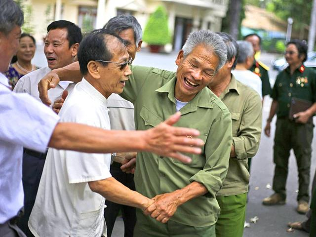 Vietnamese-veterans-who-served-in-the-same-tank-company-during-the-Vietnam-War-greet-each-other-during-their-reunion-ahead-of-the-commemoration-of-the-40th-anniversary-of-the-end-of-the-war-in-Ho-Chi-Minh-City-AP-Photo