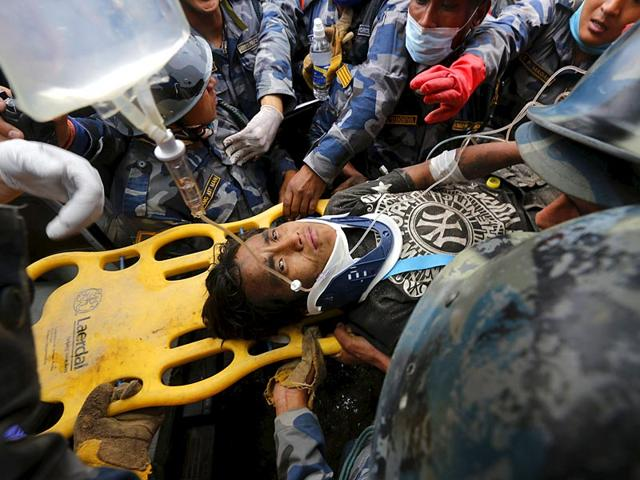 Earthquake-survivor-Pema-Lama-15-is-rescued-by-the-Armed-Police-Force-from-the-collapsed-Hilton-Hotel-the-result-of-an-earthquake-in-Kathmandu-Nepal-April-30-2015-Reuters-Photo