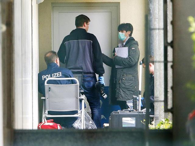 German-police-officers-secure-evidence-in-front-of-an-apartment-in-Oberursel-following-an-anti-terror-raid-in-the-city-near-Frankfurt-and-taken-a-man-and-a-woman-into-custody-AP-Photo