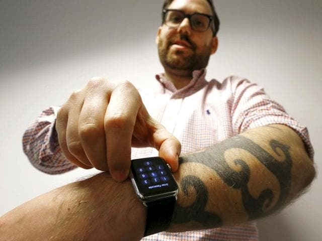 Reuters-journalist-Matt-Siegel-inputs-his-passcode-onto-his-Apple-Watch-as-his-tattoos-prevent-the-device-s-sensors-from-correctly-detecting-his-skin-in-Sydney-Reuters-photo