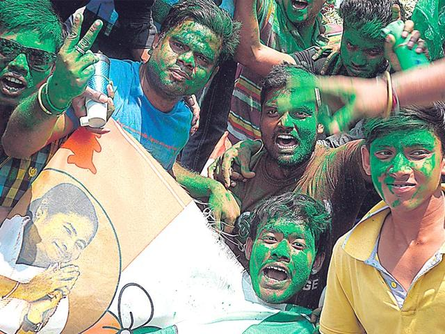 Trinamool-supporters-celebrate-a-party-candidate-s-win-in-a-civic-ward-of-the-Kolkata-Municipal-Corporation-in-Kolkata-AFP-Photo