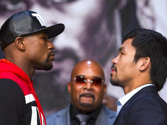 Undefeated-WBC-WBA-welterweight-champion-Floyd-Mayweather-Jr-left-of-the-US-and-WBO-welterweight-champion-Manny-Pacquiao-of-the-Philippines-face-off-during-a-final-news-conference-at-the-MGM-Grand-Arena-in-Las-Vegas-Reuters-Photo