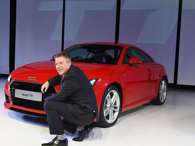 Audi-India-Head-Joe-King-poses-for-a-photograph-alongside-the-newly-launched-Audi-TT-sports-car-at-a-promotional-event-in-New-Delhi-Photo-AFP