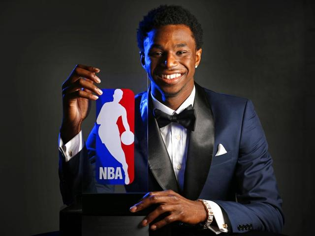 Minnesota-Timberwolves-Andrew-Wiggins-holds-his-trophy-at-a-news-conference-after-he-was-named-NBA-basketball-Rookie-of-the-Year-on-Thursday-in-Minneapolis-Brian-Mark-Peterson-Star-Tribune-via-AP