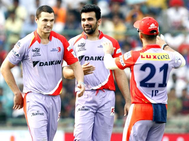 Delhi-Daredevils-players-Nathan-Coulter-Nile-Zaheer-Khan-and-JP-Duminy-celebrate-after-the-fall-of-a-Kings-XI-Punjab-wicket-during-their-IPL-2015-match-at-Ferozshah-Kotla-in-Delhi-Mohd-Zakir-HT-Photo