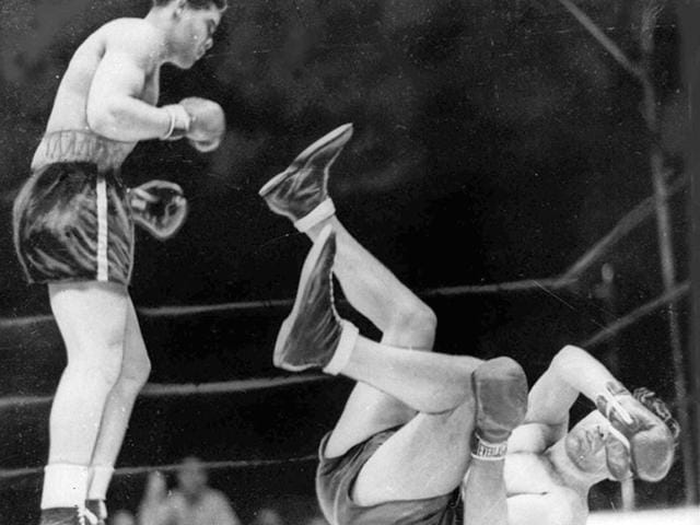 In-this-June-22-1938-file-photo-boxer-Joe-Louis-left-knocks-out-Max-Schmeling-in-the-first-round-to-win-the-heavyweight-title-at-Yankee-Stadium-in-New-York-AP-Photo