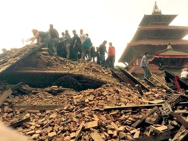 People-lift-debris-of-a-collapsed-temple-in-Nepal-Photo-credit-Bhushan-Shilpakar-via-Nepal-Photo-Project