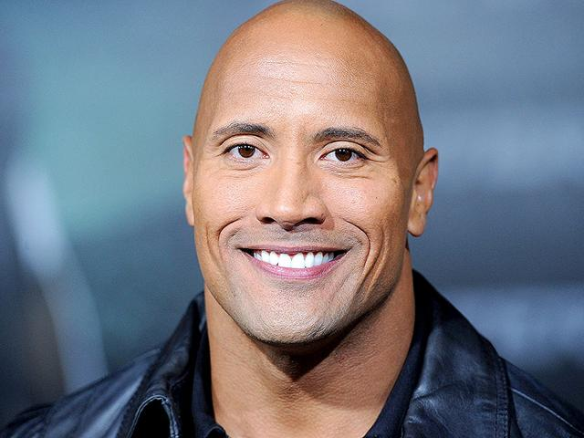 Actor-Dwayne-Johnson-greets-his-fan-as-he-walks-onto-the-stage