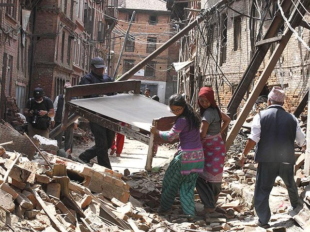 Residents-pick-up-belongings-from-the-debris-of-their-collapsed-houses-in-Bhaktapur-Nepal-Raj-K-Raj-HT-Photo