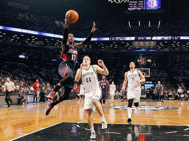 Dennis-Schroder-of-the-Atlanta-Hawks-goes-to-the-hoop-in-the-first-half-against-Bojan-Bogdanovic-of-the-Brooklyn-Nets-during-game-six-in-the-first-round-of-the-2015-NBA-Playoffs-at-Barclays-Center-in-the-Brooklyn-borough-of-New-York-City-AFP-PHOTO