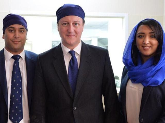 Arun-Photay-and-his-sister-Suria-with-British-Prime-Minister-David-Cameron-HT-photo