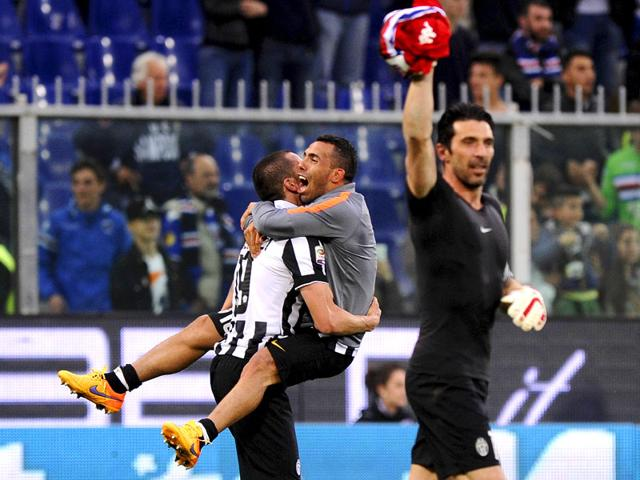 Juventus-Carlos-Tevez-C-and-Gianluigi-Buffon-celebrate-at-the-end-of-their-Serie-A-soccer-match-against-Sampdoria-at-the-Marassi-stadium-in-Genoa-Italy-on-May-2-2015-Reuters-Photo