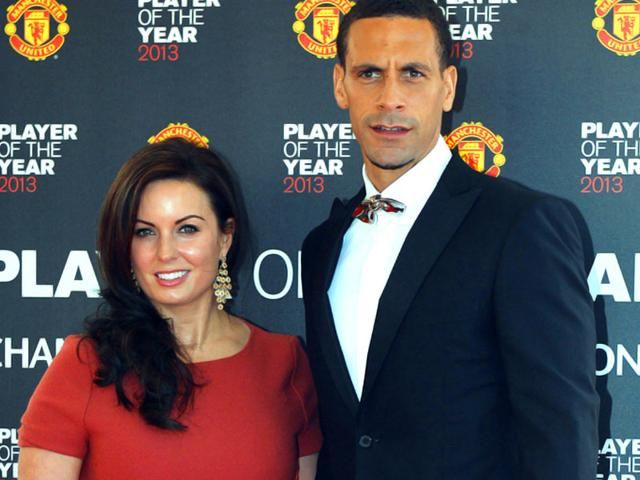 In-this-picture-taken-on-May-15-2013-Rio-Ferdinand-is-seen-with-wife-Rebecca-Ellison-as-they-arrive-for-the-Player-of-the-Year-awards-at-Old-Trafford-Manchester-northwest-England-AFP-Photo