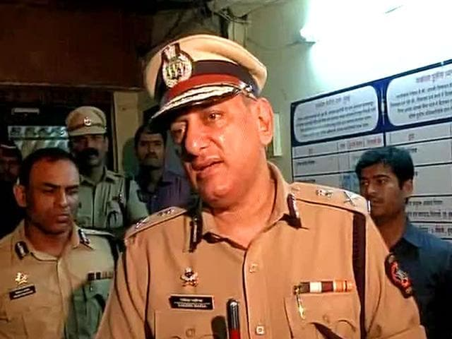 Rakesh-Maria-Mumbai-police-commissioner-briefs-the-media-on-what-happened-inside-the-police-station-where-an-officer-shot-at-another-and-then-turned-the-gun-on-himself-ANI-Photo