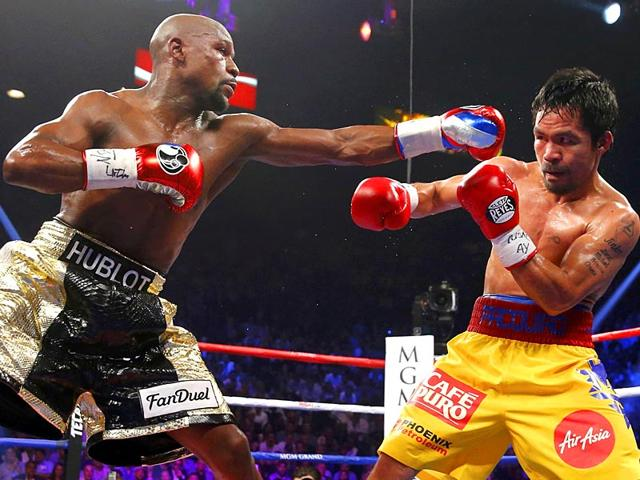 Floyd-Mayweather-Jr-of-the-US-left-and-Manny-Pacquiao-of-the-Philippines-fight-in-their-welterweight-WBO-WBC-and-WBA-Super-title-fight-in-Las-Vegas-Reuters-Photo
