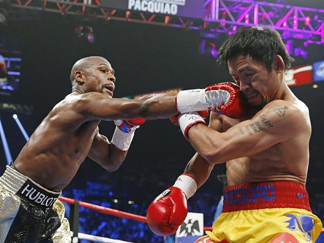 Floyd-Mayweather-Jr-left-beat-Manny-Pacquiao-in-their-welterweight-title-fight-on-Saturday-in-Las-Vegas-AP-Photo