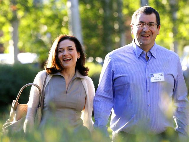 Sheryl-Sandberg-chief-operating-officer-COO-of-Facebook-arrives-with-her-husband-David-Goldberg-CEO-of-SurveyMonkey-for-the-first-day-of-the-Allen-and-Co-media-conference-in-Sun-Valley-Idaho-in-this-July-9-2014-file-photo-Dave-Goldberg-died-unexpectedly-his-brother-Robert-wrote-in-a-Facebook-post-on-May-2-2015--Reuters