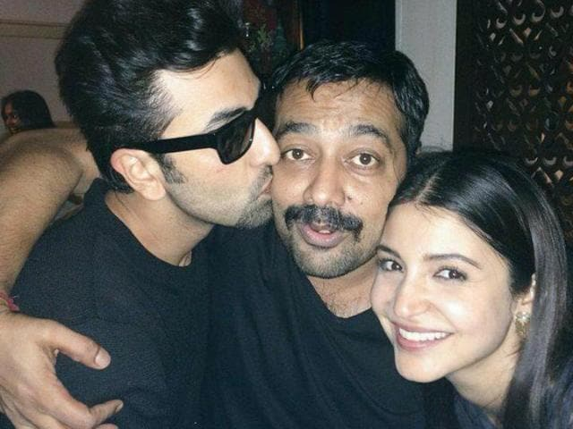 Director Anurag Kashyap poses for the camera even as Ranbir Kapoor plants a kiss on his cheecks after celebrating Anushka Sharma