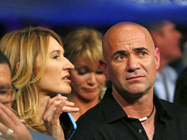 Tennis legends Steffi Graf, left, and Andre Agassi join the crowd before the start of the world welterweight championship bout. (AP/PTI)