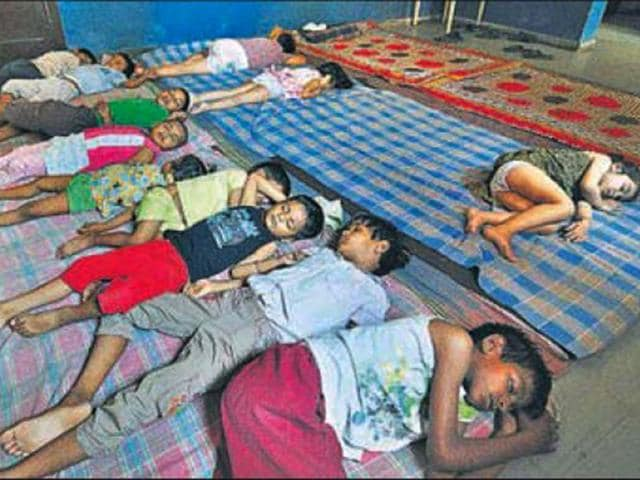 Children-taking-a-nap-on-the-floor-in-the-Sector-19-day-care-centre-Karun-Sharma-HT-Photo