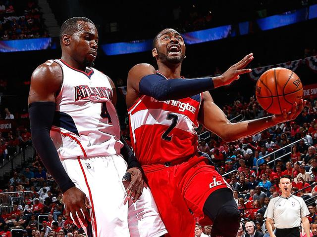 John-Wall-of-the-Washington-Wizards-drives-against-Paul-Millsap-of-the-Atlanta-Hawks-during-Game-One-of-the-Eastern-Conference-Semifinals-of-the-2015-NBA-Playoffs-at-Philips-Arena-in-Atlanta-Georgia-AFP-PHOTO
