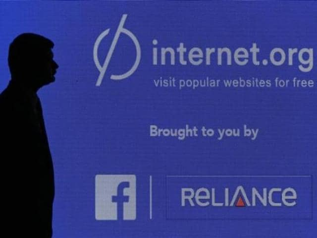 A-staff-member-stands-next-to-a-display-screen-during-a-joint-news-conference-by-Reliance-Communications-Ltd-and-Facebook-Inc-in-Mumbai-Photo-Reuters