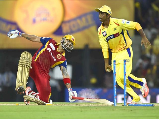 RCB-s-slide-started-from-this-moment-when-Dwayne-Bravo-effected-a-superb-reflex-run-out-off-his-own-bowling-to-get-rid-of-Virat-Kohli-Virendra-Singh-Gosain-HT-Photo