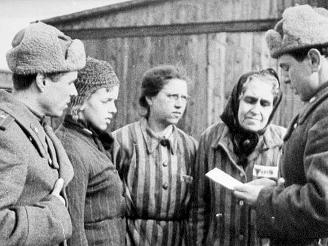 Soviet-Union-soldiers-seen-with-prisoners-they-liberated-in-the-Auschwitz-death-camp-It-is-the-role-of-the-Soviet-Union-in-liberating-the-world-from-the-scourge-of-fascism-that-the-West-wishes-to-rewrite-today-Reuters