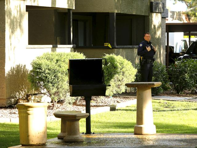 A-police-officer-guards-an-area-around-the-Autumn-Ridge-apartment-complex-which-had-been-searched-by-investigators-in-Phoenix-The-search-was-carried-out-after-Texas-police-shot-dead-two-gunmen-who-opened-fire-on-Sunday-outside-an-exhibit-of-caricatures-of-the-Prophet-Mohammad-Reuters