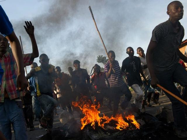 Protestors-run-across-a-fire-towards-police-lines-in-the-Musaga-neighbourhood-of-Bujumbura-AFP-Photo