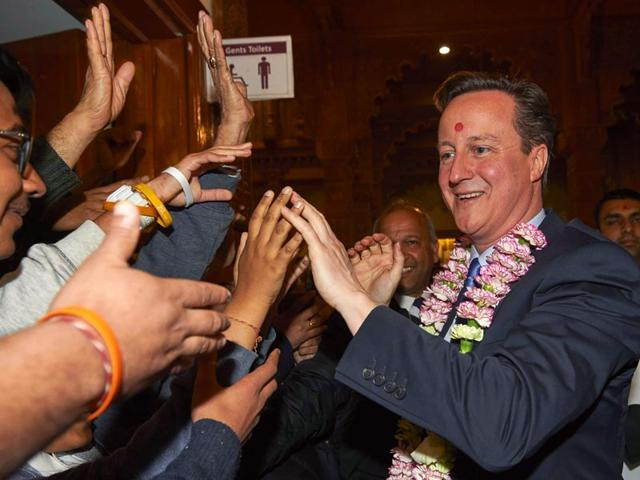 Exit-polls-have-predicted-British-PM-and-Conservative-Party-leader-David-Cameron-will-return-to-power-AFP-Photo