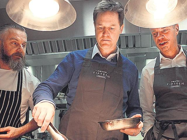 Nick-Clegg-C-leader-of-the-Liberal-Democrats-serves-breakfast-at-a-cafe-in-Newquay-England-during-an-election-campaign-on-Tuesday-AP-Photo