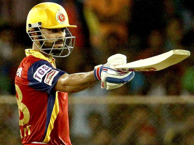 Royal-Challengers-Bangalore-captain-Virat-Kohli-raises-his-bat-after-scoring-a-fifty-against-Rajasthan-Royals-during-an-IPL-match-against-in-Ahmedabad-PTI-PHOTO