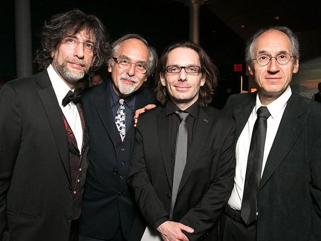 From-L-to-R-British-author-Neil-Gaiman-American-cartoonist-Art-Spiegelman-pose-with-Charlie-Hebdo-s-critic-essayist-Jean-Baptiste-Thoret-and-Editor-in-Chief--Gerard-Biard-during-the-2015-PEN-Gala-at-the-American-Museum-of-Natural-History-in-New-York-Charlie-Hebdo-recieved-the-Freedom-of-Expression-Courage-Award-Beowulf-Sheehan-AP