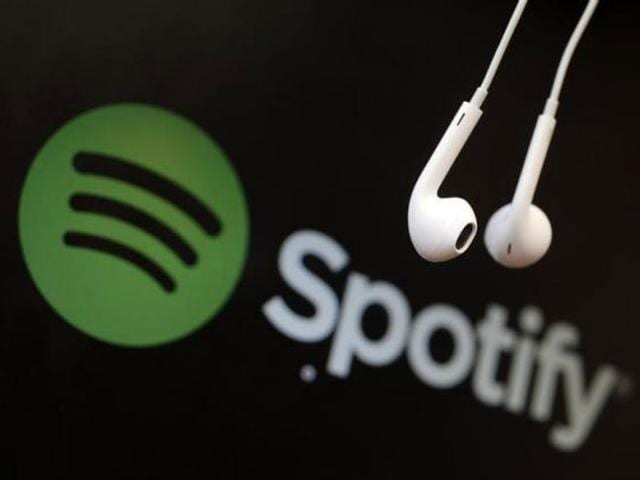 Headphones-are-seen-in-front-of-a-logo-of-online-music-streaming-service-Spotify-in-this-illustration-picture-taken-in-Strasbourg-Photo-Reuters