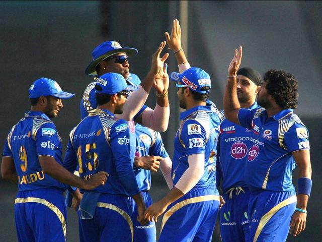 Kieron-Pollard-and-Lasith-Malinga-of-Mumbai-Indians-celebrate-with-teammates-during-an-IPL-match-in-Mohali-PTI-Photo