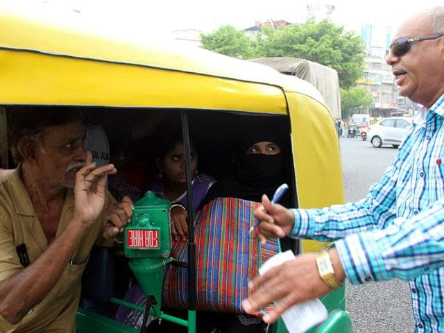 MP transport commissioner,vehicle permit,molesting women in vehicle