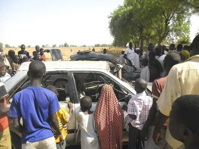 People-gather-at-the-site-of-a-suicide-bomb-attack-at-a-car-park-of-the-College-of-Administrative-and-Business-Studies-in-Potiskum-Nigeria-AP-Photo