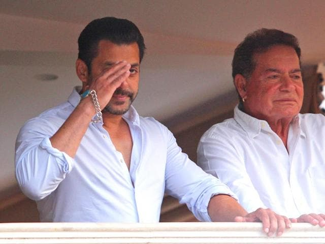 Bollywood-actor-Salman-Khan-greets-fans-from-the-balcony-of-his-home-with-his-father-Salim-Khan-standing-by-his-side-in-Mumbai-AP-Photo