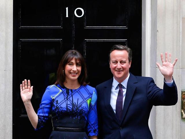 Britain-s-Prime-Minister-and-Leader-of-the-Conservative-Party-David-Cameron-and-his-wife-Samantha-pose-for-pictures-as-they-arrive-back-at-10-Downing-Street-in-London-on-May-8-2015-AFP-Photo