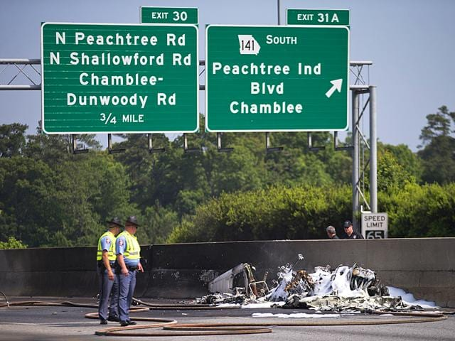 A-small-passenger-airplane-crashed-into-an-Atlanta-interstate-on-Friday-8-May-2015-killing-all-four-people-aboard-and-starting-an-intense-fire-on-the-busy-road-authorities-said-AP-Photo