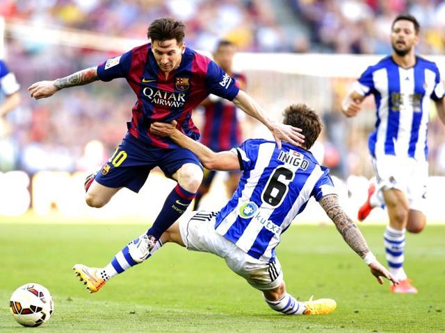 FC-Barcelona-s-Lionel-Messi-duels-for-the-ball-against-Real-Sociedad-s-Inigo-Martinez-during-a-Spanish-La-Liga-soccer-match-at-the-Camp-Nou-stadium-AP-Photo-Manu-Fernandez